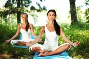 Exercise - Yoga - women outside