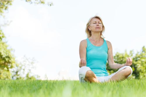 Meditation-older-woman-outside-in-blue-