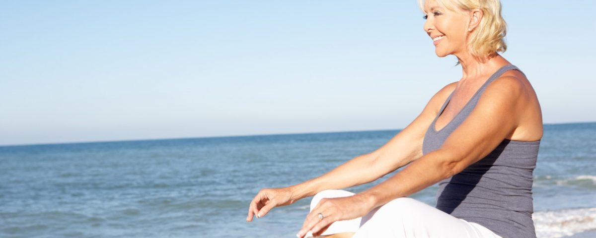 woman-sitting-on-beach